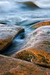 Curvy stones and wavy sea