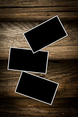 Old photo frames on a dark wooden background