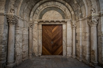 Wooden door in ancient archway