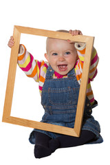 Laughing baby playing with picture frame