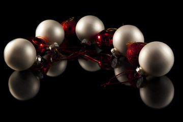 red and gold balls, christmas composition isolated in black