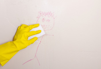 cleaning crayon off wall with magic eraser