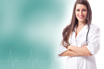 Smiling female doctor with heartbeat frequency