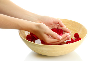 woman hands with wooden bowl of water with petals, isolated