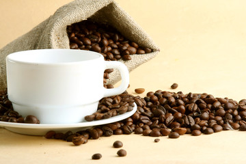 A sack of coffee beans and a cup