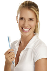young woman showing teeth brush