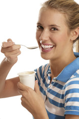 young woman eating yogurt