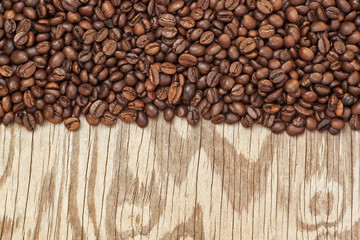 Background from coffee beans and wooden textures.