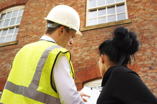 Surveyor or builder and homeowner discussing property issues