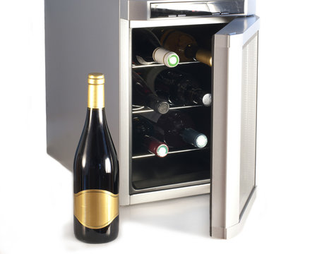 Wine refrigerator and bottle of red wine