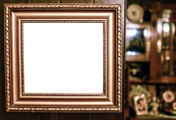 Empty vintage frame in antique room
