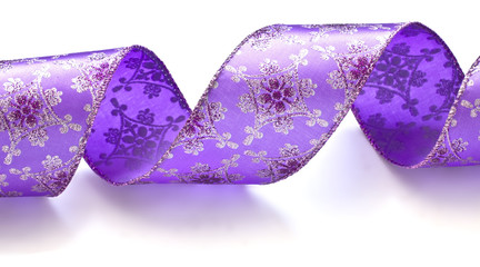 Beautiful  purple ribbon isolated on white