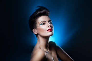 sexy attractive woman with red lips in blue light