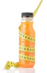 Orange juice with measuring tape