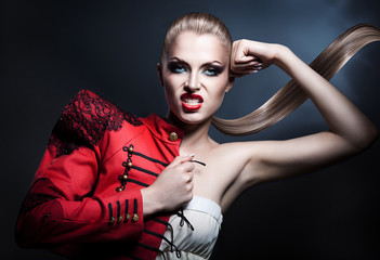 aggressive blonde woman in red