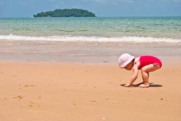 little girl is looking for shells on the beach, Otres beach, Sih
