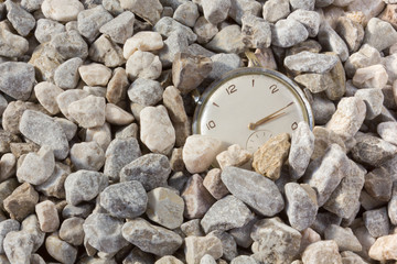 Old Watch Emerging from the Gravel