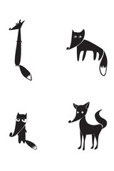 The black silhouettes of four foxes