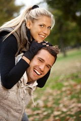 Autumn portrait of beautiful young smiling couple