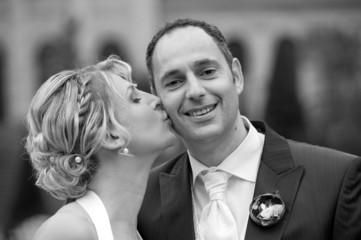 bride is kissing her bridegroom