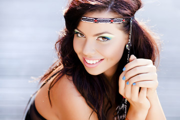 beautiful hippy woman smiling natural wearing colorful make-up