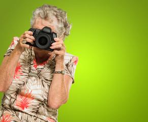Senior Woman Looking Through Camera