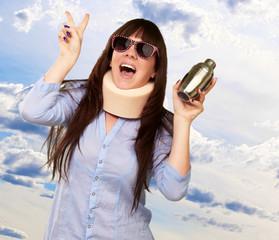 Woman Wearing Neckbrace Holding A Shaker
