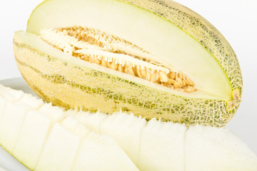 Fresh ripe juicy melon with cuts on white