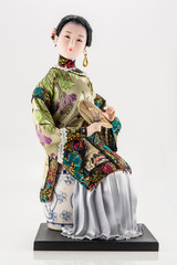 Chinese doll with fan on white
