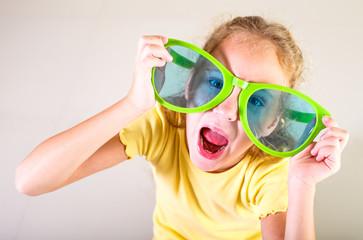 portrait of a little girl in big sunglasses
