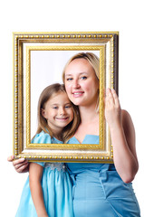 Happy mom and daughter on white