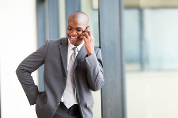 african american businessman talking on mobile phone