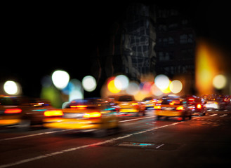 Blurred yellow cabs