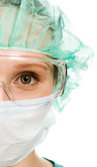 Surgeon woman in protective glasses and mask