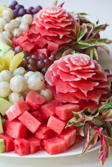 Watermelon carvings on a plate and famous tropical fruits
