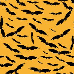seamless texture with silhouettes of bats.