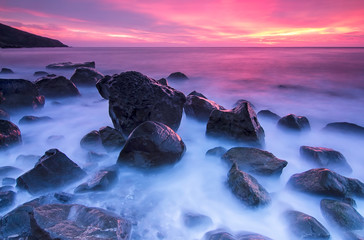 Stones in the sea at the sunset - fototapety na wymiar