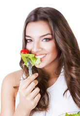 hungry beautiful healthy woman with salad
