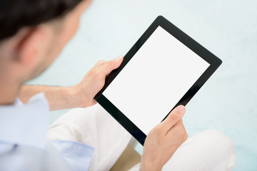 Blank tablet computer in hands