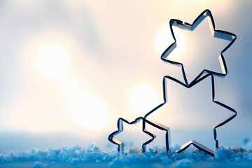 Star cookie cutters on snow crystals
