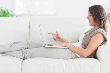 Woman using video chat on laptop