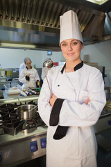 Young chef holding ladle