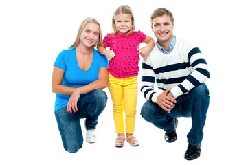 Studio portrait of charming young family