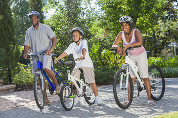 African American Parents WIth Boy Son Riding Bike