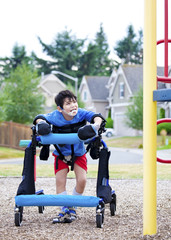 Disabled boy in walker walking up to playground