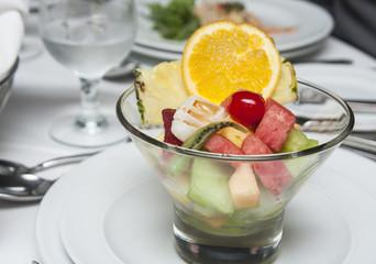 Nice Cut Fruit Bowl on Dinner Table