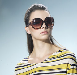 young beautiful woman with sunglasses-closeup