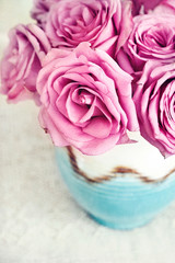 pink roses on a table.
