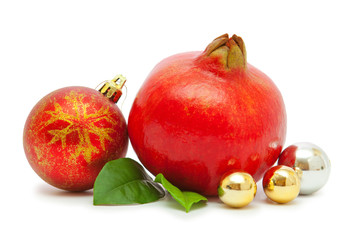 Pomegranate and christmas decorations