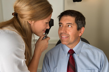 Eye Doctor Examining Hispanic Patient